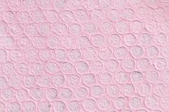 Pink Paper Texture Background. This is a photo of textured handmade paper that is pink circles that are close together Royalty Free Stock Images