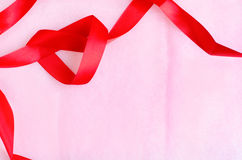 Pink paper texture background with red ribbon Royalty Free Stock Images