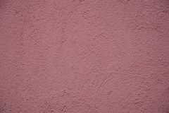 Pink paper texture of a wall stock photos