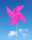 Pink paper windmill. In the sky Royalty Free Stock Photography