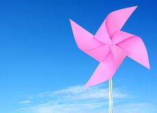 Pink paper windmill in the sky Royalty Free Stock Photos