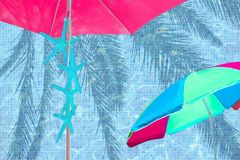 Pink parasol turquoise starfish turquoise blue pool. Water surface background stock photography