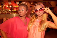 Pink party. Two young beautiful women at pink party Royalty Free Stock Photography