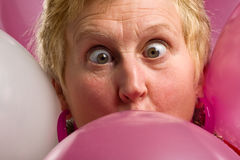 Pink party balloons face Stock Photography