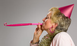 Pink party blower stock photo