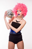 Pink party girl holding silver ball Royalty Free Stock Image