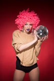 Pink party girl holding silver ball Royalty Free Stock Images