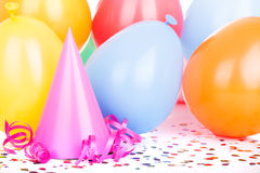 Pink Party Hat. Pink birthday party hat with balloons in background Royalty Free Stock Photography