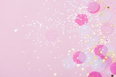 Pink pastel confetti and sparkles background. Pink pastel confetti and sparkles background, golden stars. Bright and festive. Top view, flat lay. Copyspace for vector illustration
