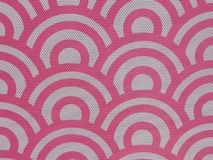 Pink pattern with speaker holes. This is a pink pattern of circles that has speaker hole in the pattern. It is a continuous pattern that is good for a background royalty free stock images
