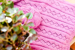 Pink pattern detail of woven handicraft knit sweater Stock Photos
