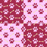Pink paw print background. Pink paw print and bone repeating background royalty free illustration