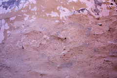 Pink and peach decorative plaster. On the wall outdoors stock image