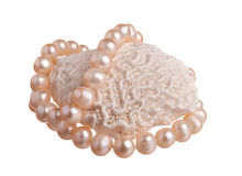 Pink pearl nacklace on a big coral Stock Photography