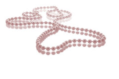Pink Pearls. Pearl string in heart shape with pink tinge Royalty Free Stock Photography