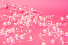 Pink Pearls. On a pink background Royalty Free Stock Images