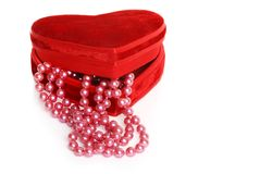 Pink pearls in a red heart box Stock Photography