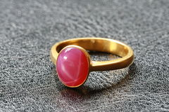 Pink pebble on gold ring Royalty Free Stock Image