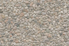 Pink pebbles. Wall covered with pink pebbles Royalty Free Stock Photography