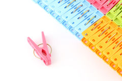 Pink peg in front of pegs row from upper Royalty Free Stock Image