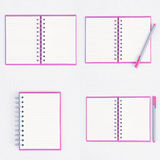 Pink Pen on Face purple notebook for background and text Stock Image
