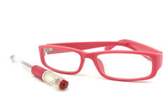 Pink pen and glasses Stock Image