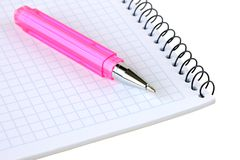 Pink pen lies on a notebook Royalty Free Stock Photo