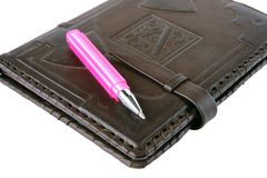 Pink pen lies on a notebook Royalty Free Stock Photography