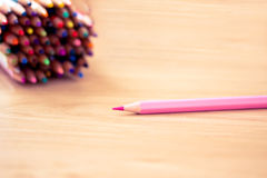 Pink pencil in focus and others as background. Some colourful pencils with a pink one in focus Royalty Free Stock Images