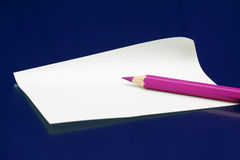 Pink pencil on white paper note Royalty Free Stock Images