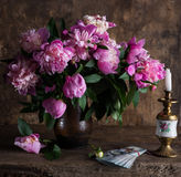 Pink peonies and  pack of dollars Stock Image