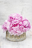 Pink peonies and roses in wooden box. Royalty Free Stock Photo