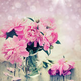 Pink peonies on wooden background Stock Photo