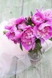 Pink peonies on wooden background Royalty Free Stock Photo