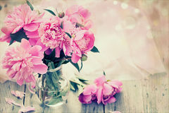 Pink peonies on wooden background - vintage photo Royalty Free Stock Photos