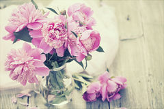 Pink peonies on wooden background - vintage photo Stock Photography