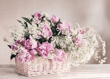 Pink peony in basket Royalty Free Stock Photos