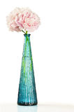 Pink peony flowers in blue vase over white Stock Photo