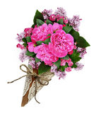 Pink peony flowers bouquet in a craft paper cornet Stock Images