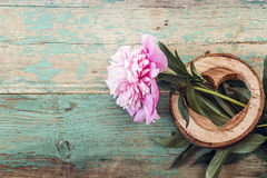 Pink peony and heart carved in wood on the old grunge painted bo Stock Image