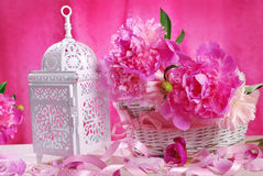 Pink peony in wicker basket and retro lantern Stock Images