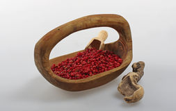 Pink pepper in a wooden bowl. Stock Photo