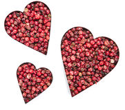 Pink Peppercorns Heart Shape (on white) Stock Image