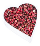 Pink Peppercorns Heart Shape (on white) Stock Photography