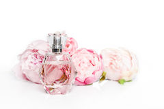 Pink perfume bottle with flowers on light background. Perfumery, cosmetics, fragrance collection royalty free stock photography