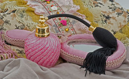 Pink perfume bottle, hand mirror and purse Stock Photos
