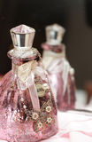 Pink perfume bottle with pendant Royalty Free Stock Images