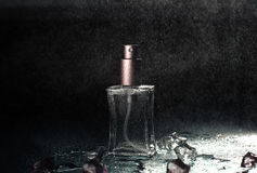 Pink Perfume with drops of water Royalty Free Stock Image