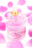 Pink perfume and rose petals Royalty Free Stock Images