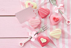 Pink Petit Fours in Heart shape. Colorful petit fours in heart shapes on pink Royalty Free Stock Photo
